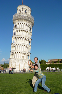 Striking the Pose holding up the leaning tower